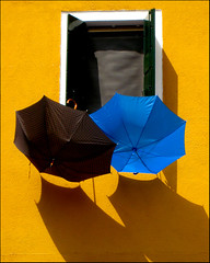 Buranello Brollies (American Jon) Tags: travel windows italy colors yellow colours burano yourfavorites cotcmostfavorited flickrsbest bluelist 25faves fivestarsgallery artlibre canonixus850is platinumphoto italy2007 diamondclassphotographer ysplix colourartaward artlegacy lpwindows lpclimate dpslessismore