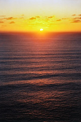Another day comes to an end (Daniel Murray (southnz)) Tags: ocean sunset sea newzealand sun clouds landscape coast scenery wave nz southisland westcoast swell southnz eos50escanfromprint