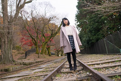 Young woman standing on dead railroad (Apricot Cafe) Tags: 20s asianethnicity japan japaneseethnicity kyoto minikyoto2016 sigma35mmf14dghsmart autumn autumnleaves beautyinnature change charming cheerful enjoying foliage freshness happiness hope japanesefallfoliage japanesemaple leaves mapleleaf nature nervous oneperson onlywomen outdoors people railroadtrack refreshing selectivefocus tranquility traveldestinations unstable walking wishing woman youngadult kyōtoshi kyōtofu jp