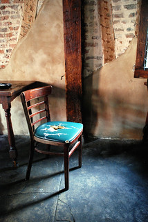 Empty Chair at Empty Table