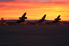 FedEx Dawn (dbcnwa) Tags: fedex fedexexpress den kden dia denverinternationalairport sunrise clouds sky dawn dc10 md10 a300 cargo ramp airport mcdonnelldouglas airbus freight aircargo airfreight colorado catchycolors orange airplane plane jet airliner planes aircraft jets canon canoneos canon350d canon70200mmf28lisusm denver canon70200f28l avion aeroplano flugzeug aeronautical aviation flying fedexdc10 fedexmd10