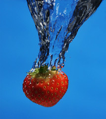 Splash (Sesselja Mara) Tags: blue red food wet water closeup fruit speed juicy healthy movement strawberry berry close sweet eating tasty fresh delicious eat health taste diet splash freshness highspeed nutrition onblue splashing healthiness supershot flickrsbest anawesomeshot colorphotoaward superaplus aplusphoto diamondclassphotographer flickrdiamond sesseljamara