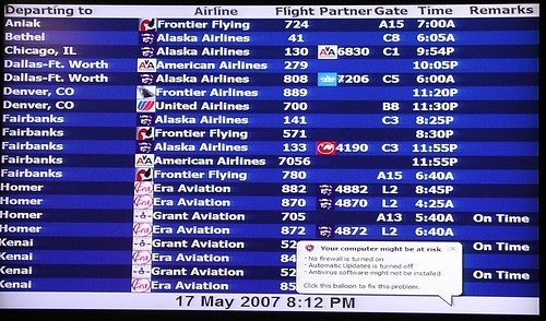 Flight board at Anchorage International Airport