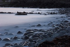 Stones (John Spooner) Tags: sea beach scotland twilight waves stones shore creativecommons seashore dumfriesgalloway galloway dumfriesandgalloway machars monreith i500 wigtownshire lucebay southwestscotland johnspooner dumgal