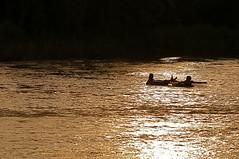 Lovers Afloat (kimshi) Tags: sunset silhouette river laos tubing vangvieng ©kimbardoel lpfloating