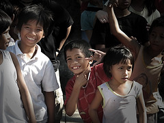 Amidst the chaos, Here we smile. (kamalayan) Tags: kids philippines overlay manila streetkids fpc s3is kamalayan fpcpacopark reuelmarkdelez