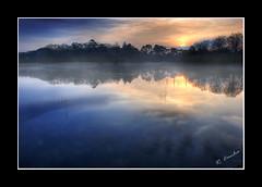 Sunrise in Emo Lake (Rodrigo da Cunha) Tags: morning trees ireland irish mist lake sol water weather fog sunrise court reflections agua nikon emo silhouettes lagos neblina reflexos irlanda nascer nevoeiro laois d80 flickrsbest