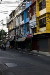 2016_04-Bangkok-M00005 (trailbeyond) Tags: photoshop architecture asia bangkok building house housing location moped outdoors residentialbuilding road street thailand transport tuktuk buildings