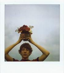 Boy With Flowers (oh it's amanda) Tags: 600 polaroid600 polaroidsx70 neutraldensityfilter faithbridge