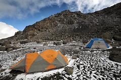 Tents at Crater Camp - Kilimanjaro National Park - Tanzania (PascalBo) Tags: nikon d300 tanzania tanzanie africa afrique eastafrica afriquedelest kilimanjaro kilimandjaro kilimanjaronationalpark parcnationaldukilimandjaro cratercamp lemosho hike hiking trek trekking outdoor outdoors volcanic rock stone tent bivouac camp campement snow neige pascalboegli