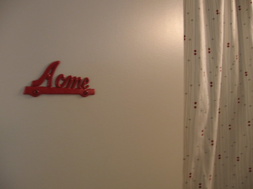 On the door, a vintage Acme sign that I painted red