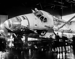 Orbiter Atlantis and Tourists (jeffk42) Tags: nasa orbiter shuttle atlantis museum display longexposure florida titusville bw blackandwhite film ilfordfp4 4x5 crowngraphic kodakektar127mmf47 presscamera largeformat