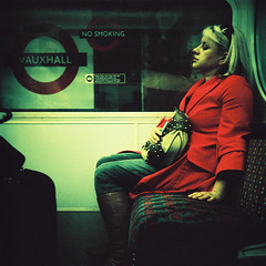 Red Woman In Tube (edscoble) Tags: red portrait london 120 6x6 tlr film girl station train underground lomo xpro sitting cross seat coat tube victoria retro line ii 200 lubitel medium format process agfa expired vauxhall rsx londonist 166b
