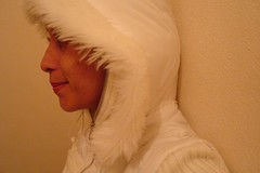 flickr280507 (le jardin public - CS Photo) Tags: winter portrait selfportrait cold girl beauty smile face female eyes retrato coat autoretrato lips piercing cap hood inverno frio whitecoat casaco