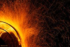 Embers Away (naturalturn) Tags: longexposure sculpture usa art wheel night fire nevada playa burningman blackrockcity flame 2008 ambition firesculpture thwarted burningman2008 wheelofthwartedambition image:rating=5 image:id=062822