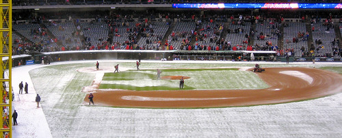 One of several delays on Opening Day 2007 in Cleveland. A quick burst of snow & the crew running out to clear the field.
