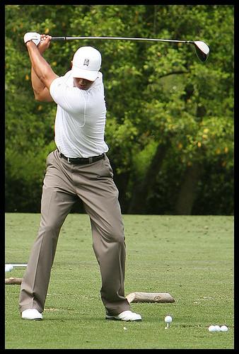 tiger woods swinging. Tiger Woods