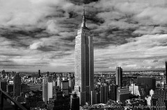 Empire State Building :: Location Scout (Sam Rohn - 360 Photography) Tags: city nyc newyorkcity sky blackandwhite bw newyork building blancoynegro skyline architecture clouds photoshop blackwhite interesting noiretblanc manhattan explore empirestatebuilding biancoenero locationscouting cs3 locationscout nikond200 bwdreams 18200mmf3556gvr monochromia filmscouting nylocations samrohn aia150 flickrdiamond filmscout