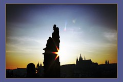 the Sunset on a Statue (! .  Angela Lobefaro . !) Tags: trip travel bridge sunset vacation sky building castle cars nature topf25 water girl night clouds river subway interestingness topv333 czech prague quality patterns gimp himmel prag charles praha praga topv222 explore nubes linux czechrepublic 300views 200views schloss charlesbridge frontpage ubuntu idyllic vltava topf10 topf15 allrightsreserved italians 2007 outstanding praguecastle kubuntu 1025faves digikam x500 someonelovesthisshot 2550faves i500 cesvi karlsbridge natuzzi bestphotosonflickr bestpicturesonflickr anawesomeshot holidaysvacanzeurlaub angiereal goldenphotographer superhearts theunforgettablepictures 1outof500 noqualitynocry maxgreco angelalobefaro angelamlobefaro wwwcesviorg angelamarialobefaro massimilianogreco