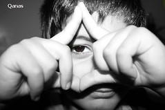 Look Through My Eye (.ღ♫°Qanas°♫ღ.) Tags: wow child imagination eye hands august august05 2005 canon look boy black white childhood interestingness