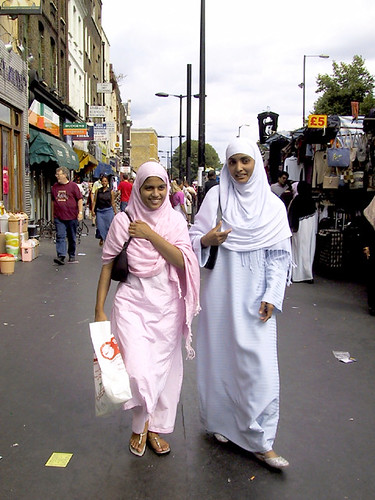 Muslim girls shop at Whitechapel Market in London.