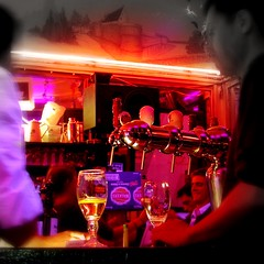 pinholing at caf noir ([phil h]) Tags: city light summer urban 15fav paris france color colour beer topv111 bar night square evening topv333 picasa2 picasa olympus topv222 pinhole boring blacklight squareformat stellaartois parisist squared tab mondaynight cafnoir pinholeeffect
