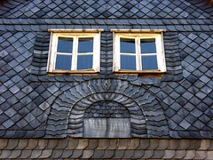 Sad face? (:Linda:) Tags: above blue summer two house building texture window face wall germany tile town fenster shingle august thuringia below slate blau twowindows schiefer untermassfeld resembling ähnlich slateshingle slateshingled schieferschindel zweifenster