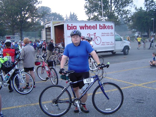 fat guy on bike pic. Fat guy getting ready to ride.
