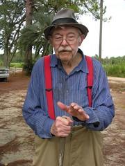 Mr. Weaver Tells About Building the Log House (Old Shoe Woman) Tags: usa georgia southgeorgia dilosep05 mrweaver seniorcitizen hat cane talking dilosept05