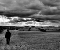 . A Portrait of James : Hemingtow, Part (ii) . (3amfromkyoto) Tags: camera white man field shirt clouds walking beard glasses james countryside suffolk horizon jimmy overcast september well moustache suit story sombre series hoover dressed hemingtow 3amfromkyoto flickr:user=3amfromkyoto