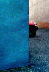 red car, cornered (Mr.  Mark) Tags: city blue red color colour deleteme9 car wall wow interesting alley topv333 savedbythedeletemegroup grain minimal saveme10 200 500plus20 100 topf200 flickrchallengegroup markboucher world100f safedomino