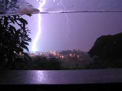 Thunder Fall (.::::. Irving .::::.) Tags: 2005 lighting city longexposure light sky white storm luz rain weather electric night canon dark mexico luces noche casa crazy fantastic flickr ray shine purple nightshot ciudad paisaje powershot tepic nayarit powershota75 bolt tormenta electricity shock spike lightning hack rayo behavior a75 thunder descarga trueno sumer rayos clima morado relampago 555v5f lightingstorm interestingness155 i500 230countriesmexico xls54 msfavorita