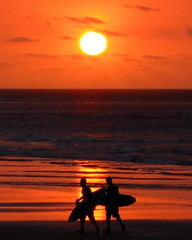 day is done (Farl) Tags: surfers surfboards beach red orange famous sunset circle round sun reflections surf kuta pantai indonesia