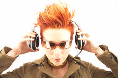 Flaming Hair with Headphones (DH Kong) Tags: headphone red hair flaming sunglasses music portrait woman fashion beauty cool hip tag1 tag2 tag3 taggedout 100v 10f interestingportrait 444v4f