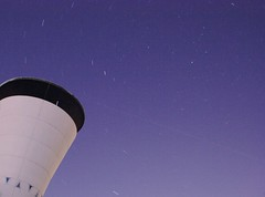 Celestial Vortex (Stopped.) Tags: blue building public night germany stars 350d lenstagged stuttgart watertower startrails canon1855f3556 mglingen