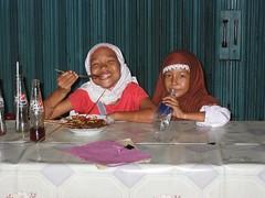 look at that SMILE!!! (uninvolved observer) Tags: travel 15fav favorite food smile topv111 kids indonesia eating deleteme10 muslim hijab jakarta myfavs 2favs cotcpersonalfavorite
