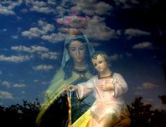 shrine (Mary Hockenbery (reddirtrose)) Tags: newmexico reflection topf25 clouds topv555 topv333 madonna jesus reddirtrose virginmary socorro