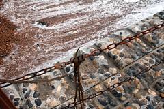 wave rolls back out (davebushe) Tags: brighton oldjetty jetty sea ocean water chain seaweed foam stone wave
