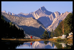 Hiker Reflecting On Beauty, High Sierra (Buck Forester) Tags: mountain lake mountains reflection nature canon landscape nationalpark hiking peak backpacking pacificcresttrail pct hiker wilderness tarn jmt highsierra elan7 70200mm fujivelvia kingscanyonnationalpark johnmuirtrail mountainpeak beautifullake clarenceking sierravisions sierravision mtclarenceking hikerreflection backpackingiserra