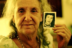 Old woman with a photo