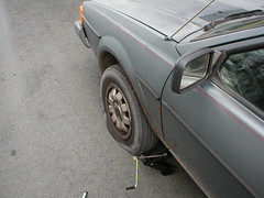 lame, but changing a tire beat being inside working (tbone_sandwich) Tags: vw scirocco flattire grey gray volkswagen wheel tire street pavement lame bummer lunchbreak jack flat roadside november