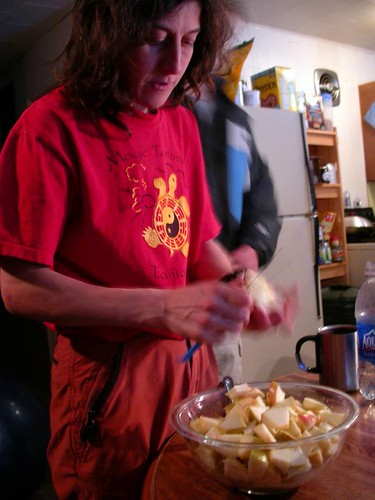 Rozz slicing apples for pie, Thanksgiving 2005 (Jesse in background)