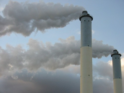 factory smokestacks spewing pollution