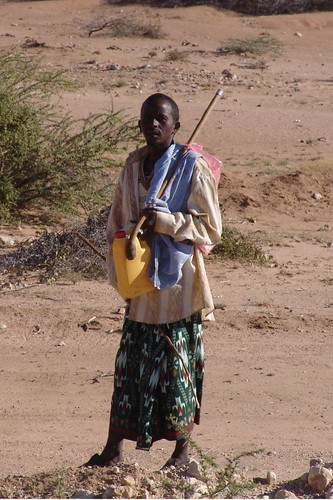 Nomad with stick and  water cannister