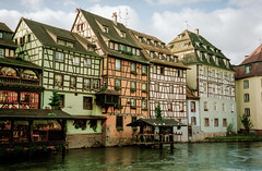 Half-Timbered Houses, Strasbourg (Cameron Booth) Tags: 2003 vacation france geotagged canal europe day cloudy historic unescoworldheritagesite strasbourg alsace lapetitefrance petitefrance halftimbered basrhin scannedfromnegative interestingness225 i500 explore24jan06 riverill