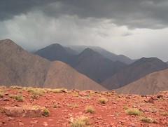 storm over the atlas mountains (Jason Webber) Tags: red cloud mountain storm rain stone explore morocco atlas