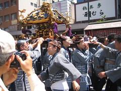 Women carrying portable shrine