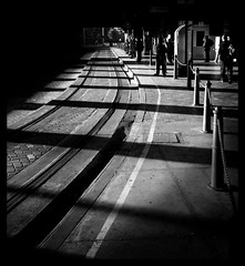 Conscientious early-morning commuters (markdanielowen) Tags: markdanielowen central train station railway city rail cityrail centraltrainstation centralrailwaystation tram sydney new south wales nsw newsouthwales australia cbd light shadows black white blackandwhite blackwhite bw paintinglight early morning earlymorning people workers suits waiting waitingforthetram cold winter autumn dewy sunrise sydneysunrise sun rise lights highlights instantfave abigfave canon30d canoneos30d canon eos 30d dslr digital slr digitalslr markowen markowenphotography mark owen photography soe