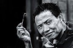 DIY Hair Colouring (Axel Halbgebauer) Tags: laos street bw blackandwhite blackwhite portrait people face asia southeastasia travel toothbrush sonyalpha sonyimages sony6300 streetphotography streetportait