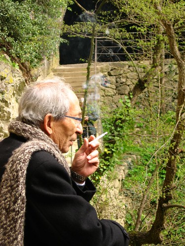 Man smoking outside Škocjanske caves, Slovenia